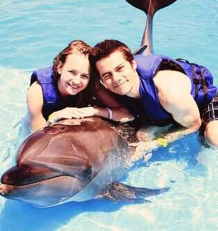 Britt Robertson and Dylan O'Brien with a dolphin