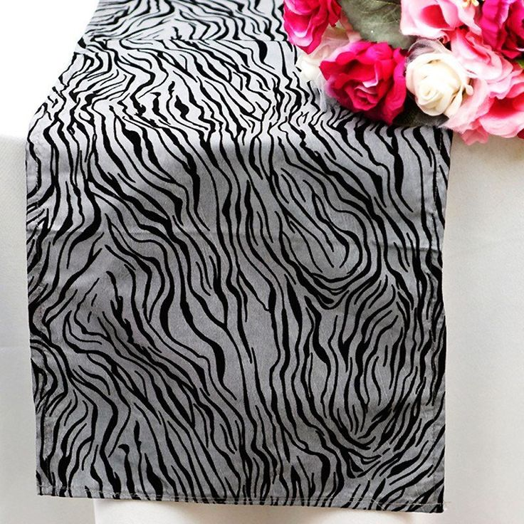 Abstract Table Runner - Silver / Black | Knowing you, you've got a lot of big ideas and spectacles planned, so we've brought you some very wild and unique tiger overlays that not just make your tabletops stunning, but also sets the mood for excitement. Appropriately named Vegas for Las Vegas, the center of entertainment in the world, this linen is only meant for someone who wants to create excitement in LARGE quantities, Las Vegas style.