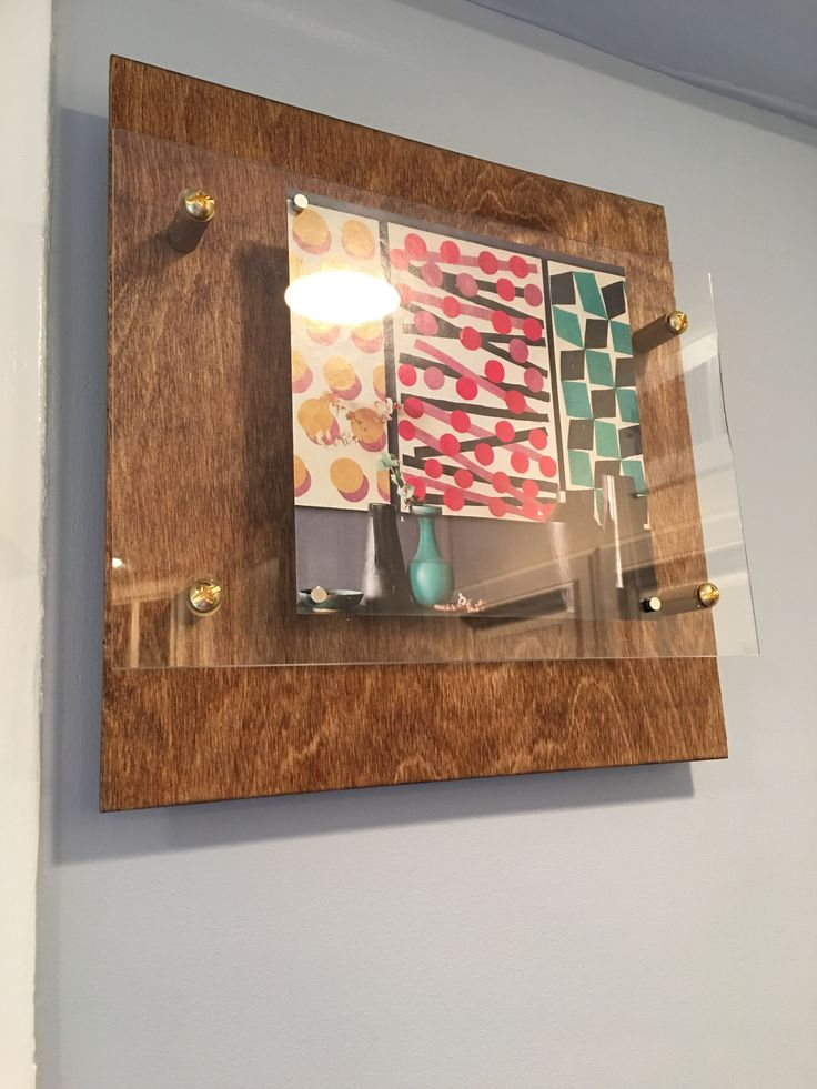 Wood Floating Display Frames in the kitchen – DIY frame attaching acrylic to stained 12x12 plywood. Attached with spacers and machine screws and mounted to wall with Command strips.