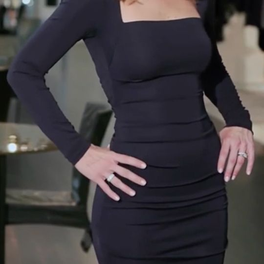 That muffin top doesn't stand a chance when you hide it behind a rouched dress.