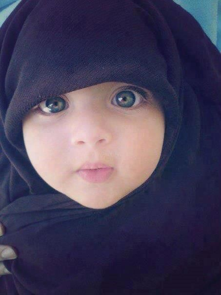 Gorgeous baby...... There is no point covering babies, Islam does not command any of this.