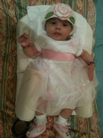 Cute Alina Prieschal wearing Smitten Flutter crochet cloche hat