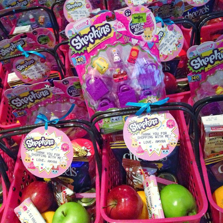 Party favors in little dollar store baskets! Cute idea.