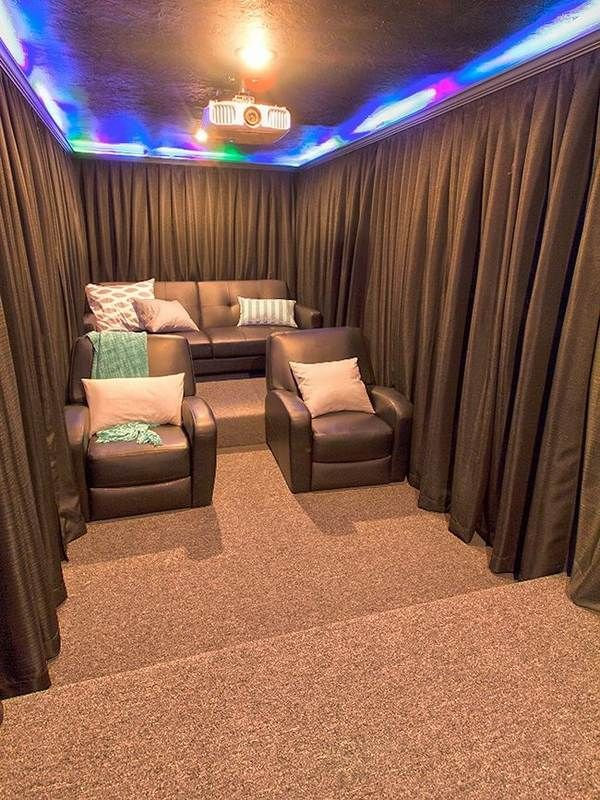 soundproof curtains small home theater design ideas brown curtains leather armchiars - Home Theater Rooms Design Ideas