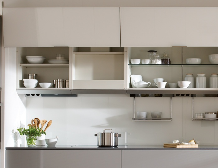 SANTOS kitchen. Comfort and beauty. The wall units for pull-out hoods, apart from offering extra storage space, allow the hood to be fully integrated in the wall area once it is closed.  They help maintain the uniformity of the kitchen whilst making cleaning easier. It is easier to clean a cabinet than to clean a stainless steel decorative extractor hood.