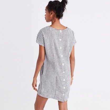 Lightweight and breezy, this striped dress has buttons all the way down the back. /