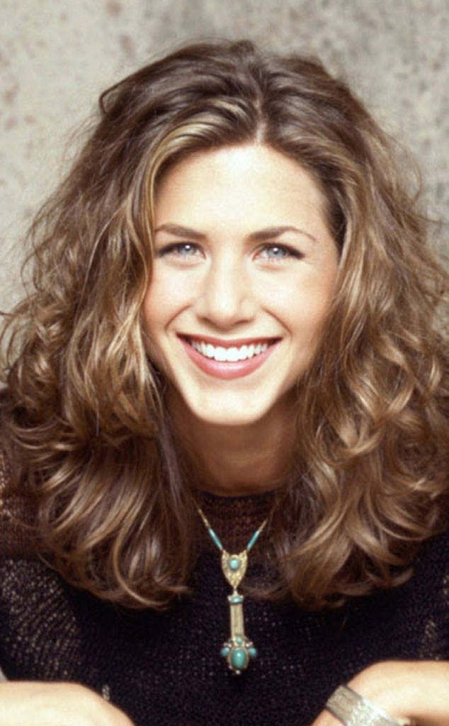 1994 from Jennifer Aniston's Hair Through the Years  One of the world's most famous blondes is actually a natural brunette—with curls to boot!
