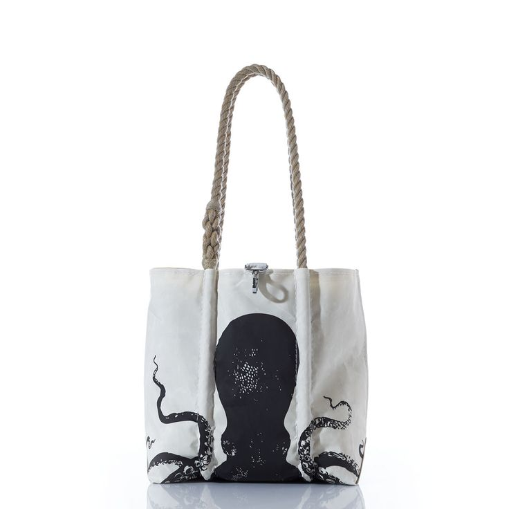 Octopus Handbag.  Octopus Tote, with Charles Darwin Notes Lining. Sea Bags Maine. Handmade from recycled sails.  This dramatic Handbag features an illustration from the official expedition report of the HMS Challenger, the 1872-76 scientific cruise that established the field of oceanography. Our octopus is, printed with ink as dark as his own; on sails that have known the sea. The lining is printed with Charles Darwin's handwritten notes from The Origin of Species, for added intrigue.