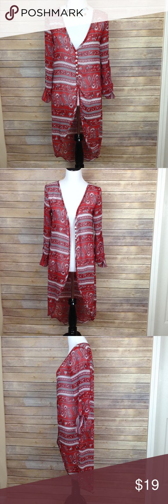 "Charlotte Russe semi sheer hi lo long red kimono I bought this kimono NWT and wore it one time! I LOVE the colors and the style. But I just can't make it work! I kept pulling the sleeves up and adjusting the neck and pulling it down...etc  Can unbutton the front but not the sleeve buttons.  I think this would look cute with a sleeveless turtleneck on cooler days or with a bralette in the summer.  APPROX FLAT MEASUREMENTS  43"" ↕️ in back sleeves are 18"" to button tab  18"" ↔️ armpits…"