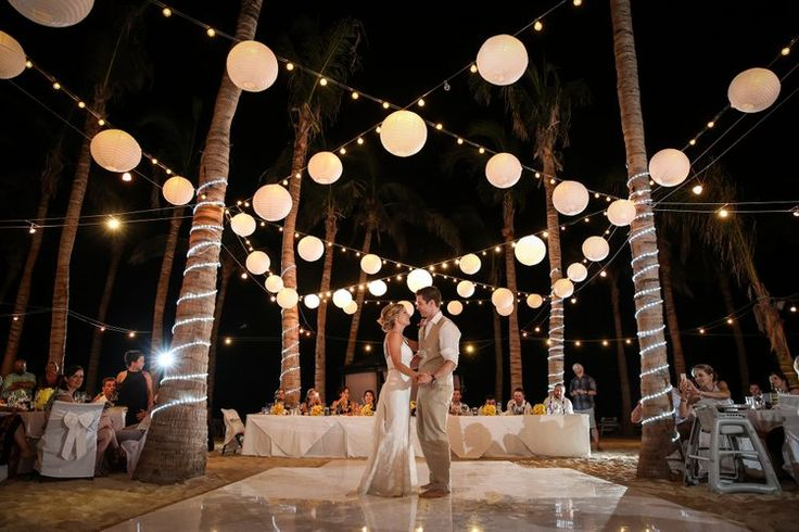 Gorgeous beach wedding decoration with paper lanterns. Love this.