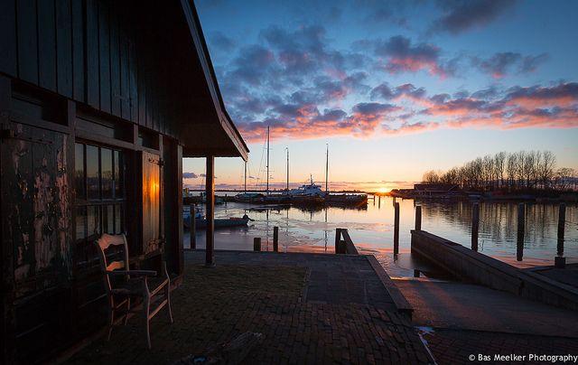 A shed, a chair and a sun - Lake Lauwersmeer, The Netherlands Museumhaven Het Booze Wijf is en omgeving is een geliefde plaats voor fotografen.