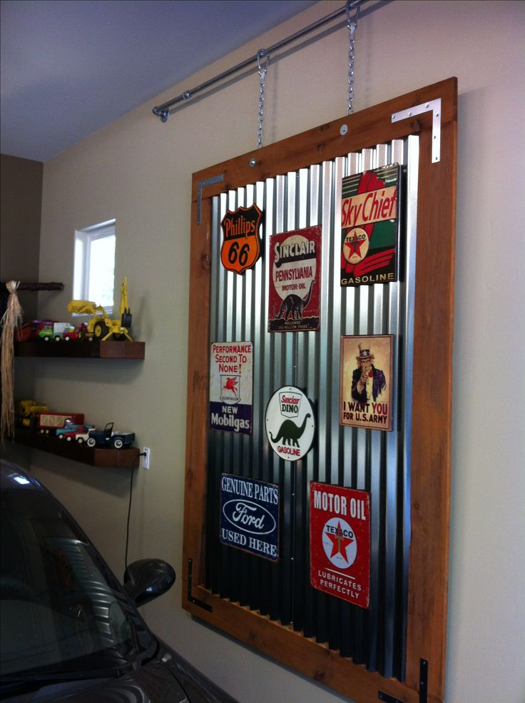 """I love it when a plan comes together!  A couple of galvanized corrugated panels, 1""""x6"""" boards for the frame with galvanized hardware, lots of screws, vintage gas station tin signs, strong magnets and the result is...a very cool artsy panel for the garage.  Really happy with the result!!"""