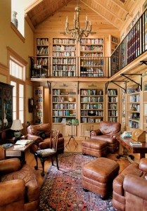 The two-story library holds the couple's extensive collection of books. Note the secret doors in the stacks. Photo: Eric Roth