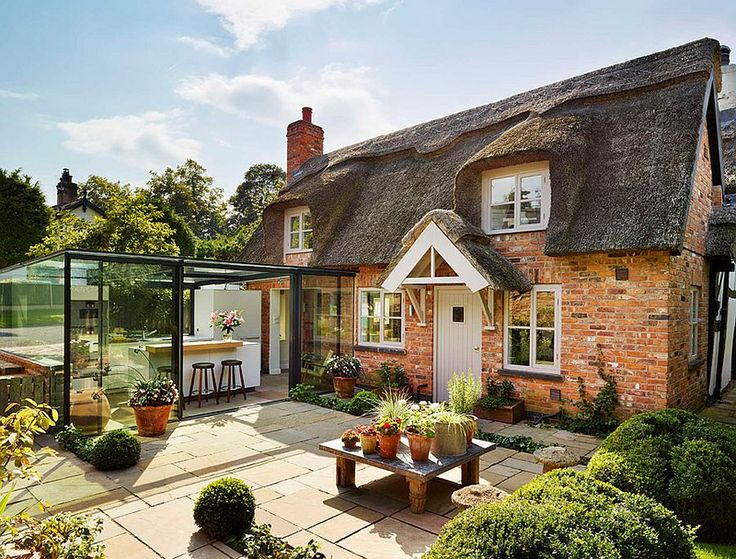 Glass kitchen extension leaves the original cottage extension untouched Dreamy 18th Century English Cottage Acquires an Inspired Glass Box Kitchen