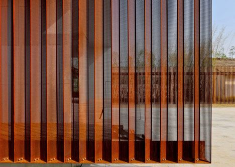 Corten Steel and mesh shades farm visitor centre in China by Vector Architects