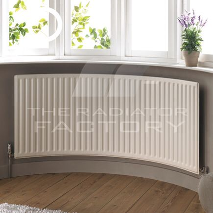 Curved radiator for a bay window