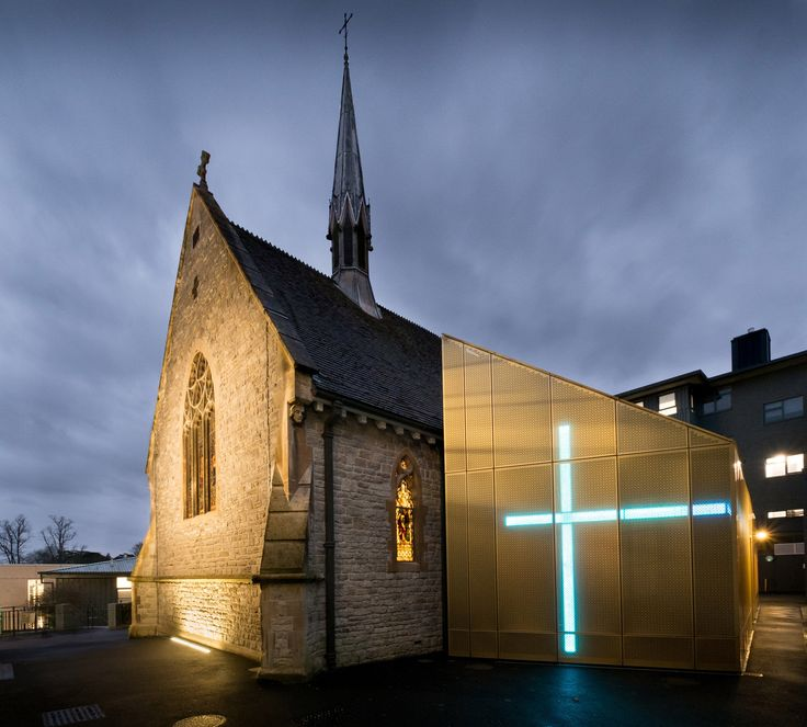 """The gothic-revival chapel at the University of Winchester, England, has been """"returned to its former glory"""", following a renovation and extension by local architecture studio Design Engine."""
