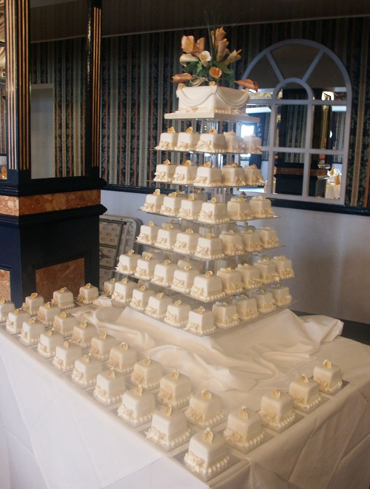 100 square mini wedding cakes in sponge and rich fruit flavours. http://www.annescakecreations.co.uk/mini_cakes.html
