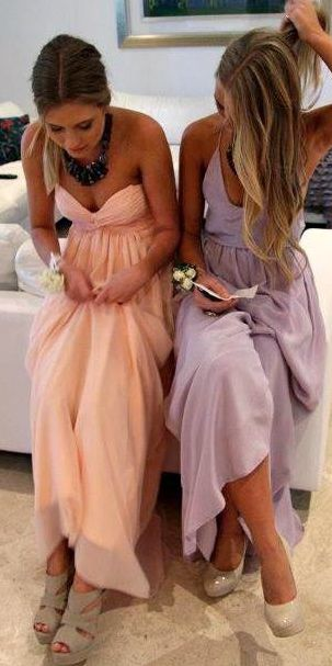 i love the idea of pastel color bridesmaid dresses. i would totally wear the pink dress normally and i love the necklace shes wearing. even the simple side pony is cute.