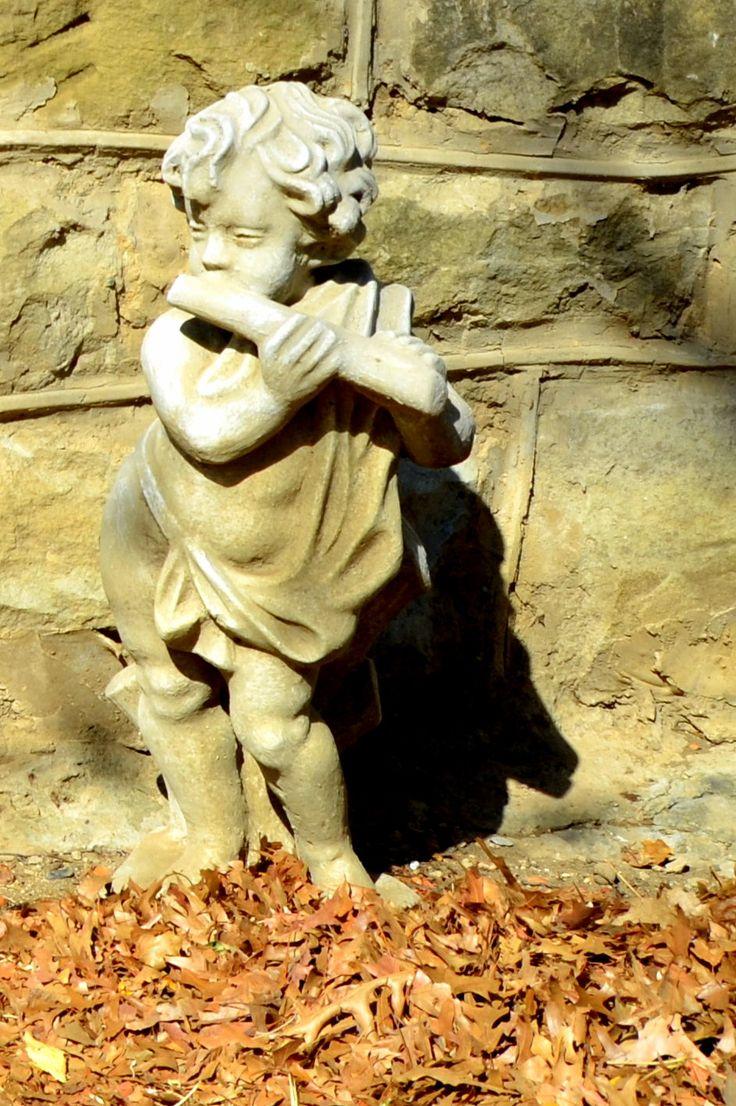 Cherub figure at #graveyard of The Little #Church, Van Reenen's Pass by Rosemary Hall