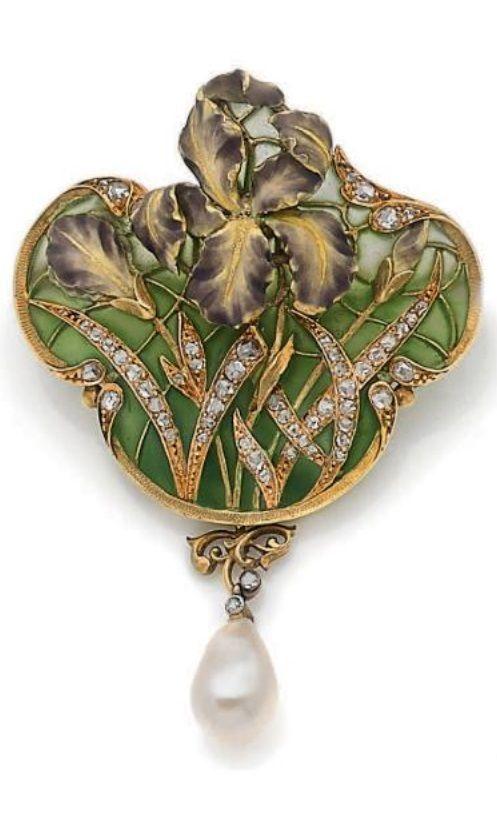 An Art Nouveau gold, plique à jour and polychrome enamel, diamond and pearl brooch/pendant, circa 1900.