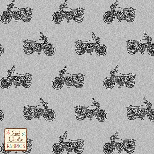 Vintage Motorcycle on Heather Grey Cotton Jersey Blend Knit Fabric - A Girl Charlee Collection exclusive. A vintage style motorcycle outline in a black hand drawn design on our signature heather grey poly cotton blend knit. Fabric is very soft, light to mid weight, and has a nice stretch and drape. Motor bike measure 1 3/4 cm wide. A versatile, fun fabric that is great for many applications. A top quality knit fabric made in Los Angeles, USA.