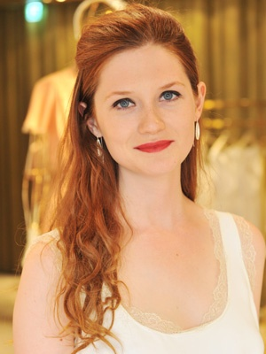 Bonnie Wright with half-up red hair    They say redheads shouldn't wear red lippy but Harry Potter actress Bonnie Wright proves that two rouges do make a right.