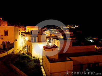 Fishermen village at night with lights and white houses