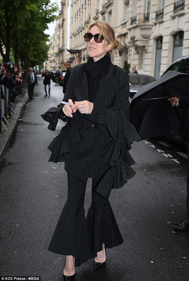 Chic: Celine Dion oozed Parisian glamour in a frilled pinstripe suit as she stepped out of...