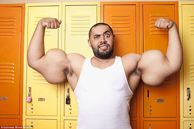 Biggest biceps: Popeye lookalike Moustafa Ismail, 24, from Massachusetts, has spent ten years pumping iron twice a day to get his 31in biceps. He eats lots of chicken rather than spinach - which he hates