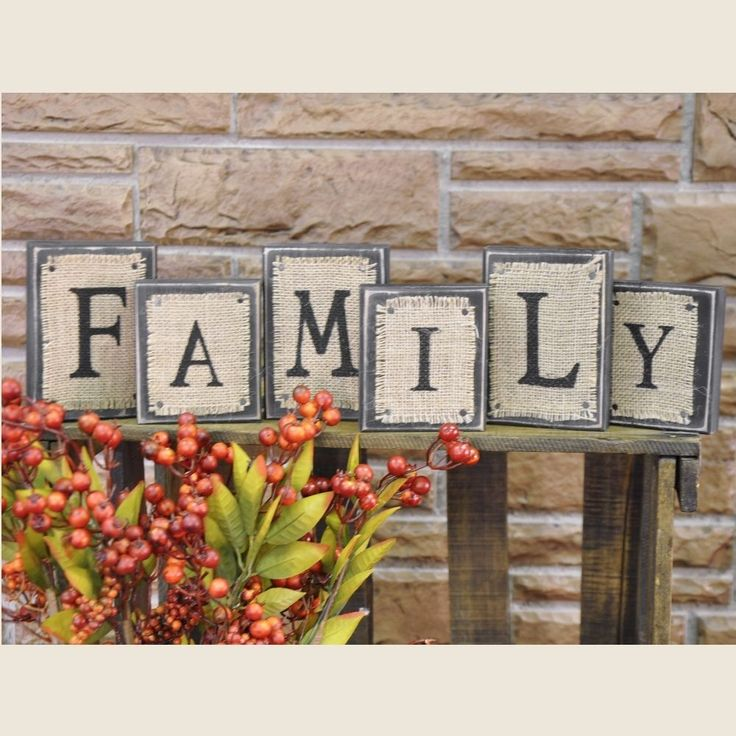 """<p>Country primitive style Family Burlap Blocks are a great decorative accent on a table, shelf, counter, or desk. Made of wood, painted black with a distressed look, blocks are topped with a piece of canvas with stenciled letter. Size varies: 3.5"""" wide x 4"""" or 5"""" high.</p>"""