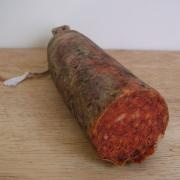 Sobrasada Sausage. Is a cured sausage from The Balearic Islands, made with pork meat +paprika+ salt and other spices.But to eat it they spread it on slices of bread . It's use also in different culinary preparations.