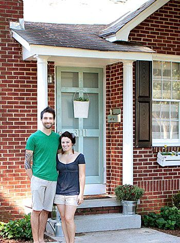 Brick house, mint door, black shutters