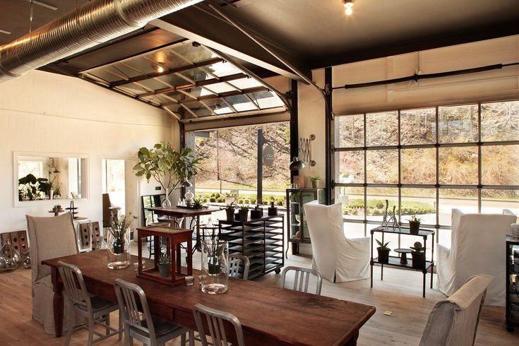 glass patio garage doors living room eclectic with view wooden console tables