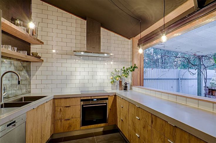 Raw Concrete counters, rustic cabinets, subway tiles with gray grout