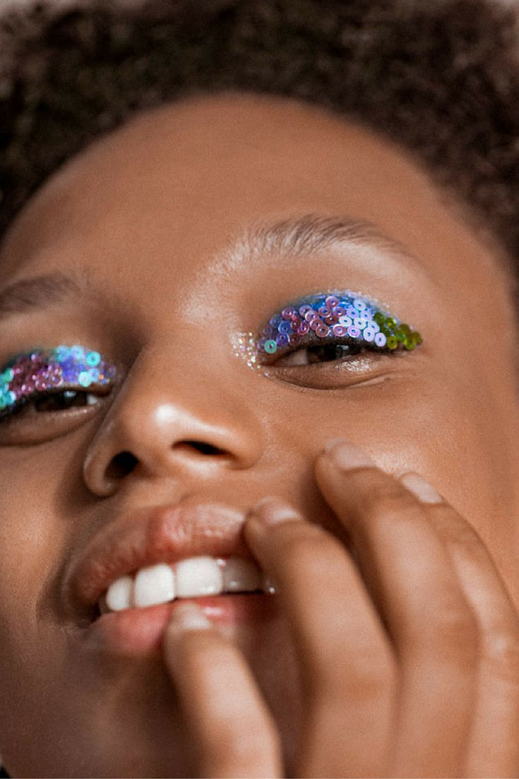 Model Afrodita Dorado wears a mermaid glitter eye