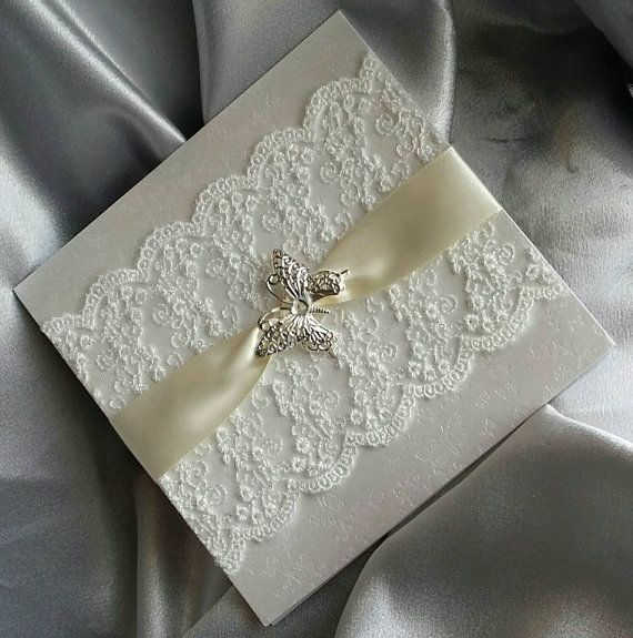 Hand made butterfly and lace trimmed pocket by AmberInvitations
