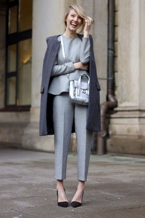modern suit with peplum top, grey overcoat, phillip lim bag