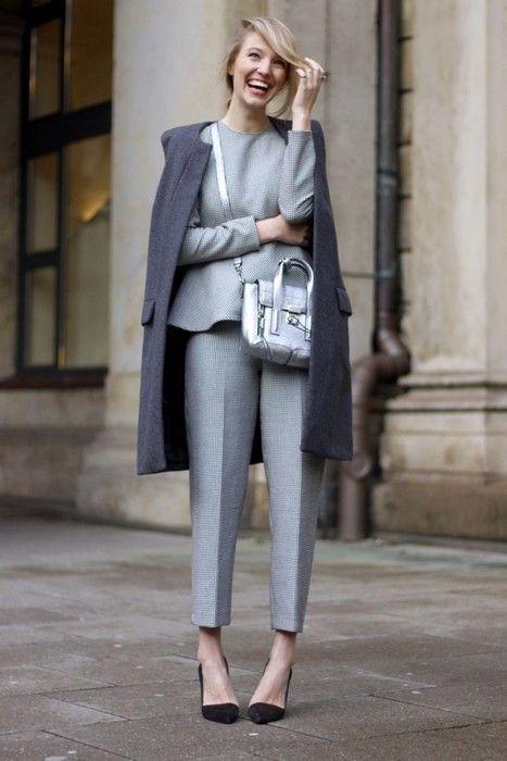 modern suit with peplum top, grey overcoat, phillip lim bag