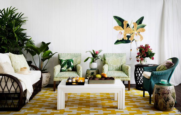 Team upholstered pieces and curvy rattan furniture for a satisfying blend of style and comfort...