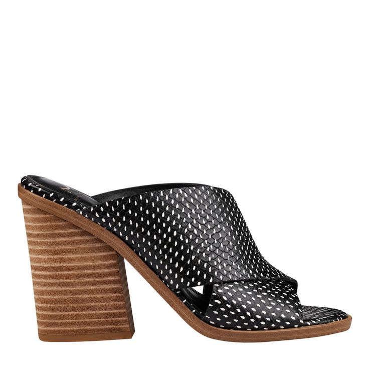 The Volla is a leather slip-on mule sandal with criss-cross detailing and