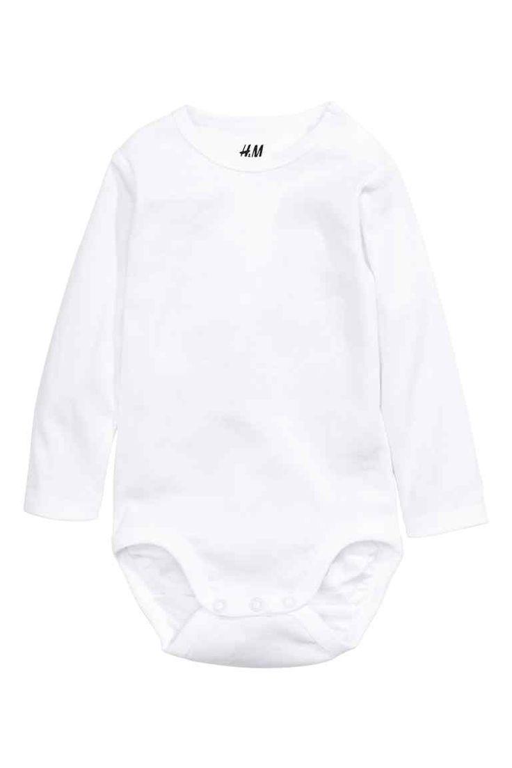 Body de manga comprida: CONSCIOUS. Body de manga comprida em jersey canelado macio confecionado em algodão orgânico com botões de pressão num ombro e entrepernas.