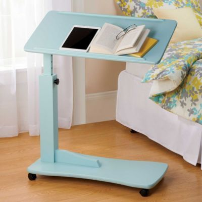 Simply glide the Adjustable Bedside Table under your bed to comfortably eat, read, or watch movies on your laptop.