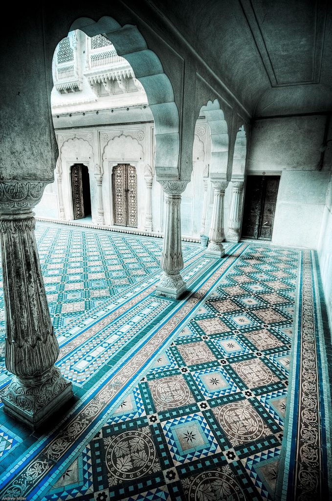 beautiful and geometric tiles lead your eye around the space, pleasingly offset by the feminine arches of the white building