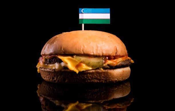 uzbekistan flag on top of hamburger isolated on black background