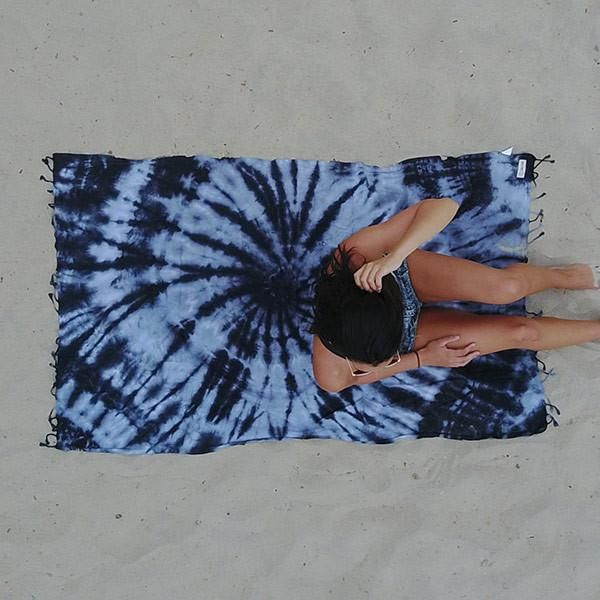 """This Purple Swirl Beach Towel will be the grooviest towel at any beach, festival, or park. This towel is the definition of """"Peace, Love, and Good Vibes."""" With its radical patterns you are totally ready to kick back and have a great time!"""