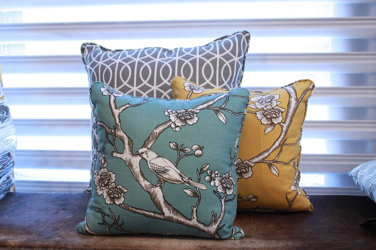 Vintage Blossom in Citrine and Jade, and Bella Porte in Charcoal.   Fabrics range between $40-$50 per yard.