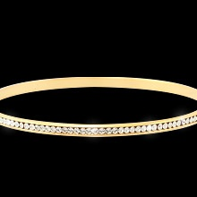 """""""Crystal Bangle""""  $49.99 CAD - The beauty never ends with a continuous single row of clear channel set Swarovski crystals. Finished in gleaming gold or rich rhodium. 6.5"""" bangle. Nickel and lead free. One gold and one silver bangle available."""