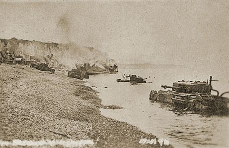 Churchill tanks of the Calgary Regiment litter the stony beach in this photography taken by a German war photographer, as Tank Landing Craft No. 5 continues to burn well after the raid had ended, the tank troopers had been taken prisoner and the flotilla had returned to England. (Rob Alexander collection)