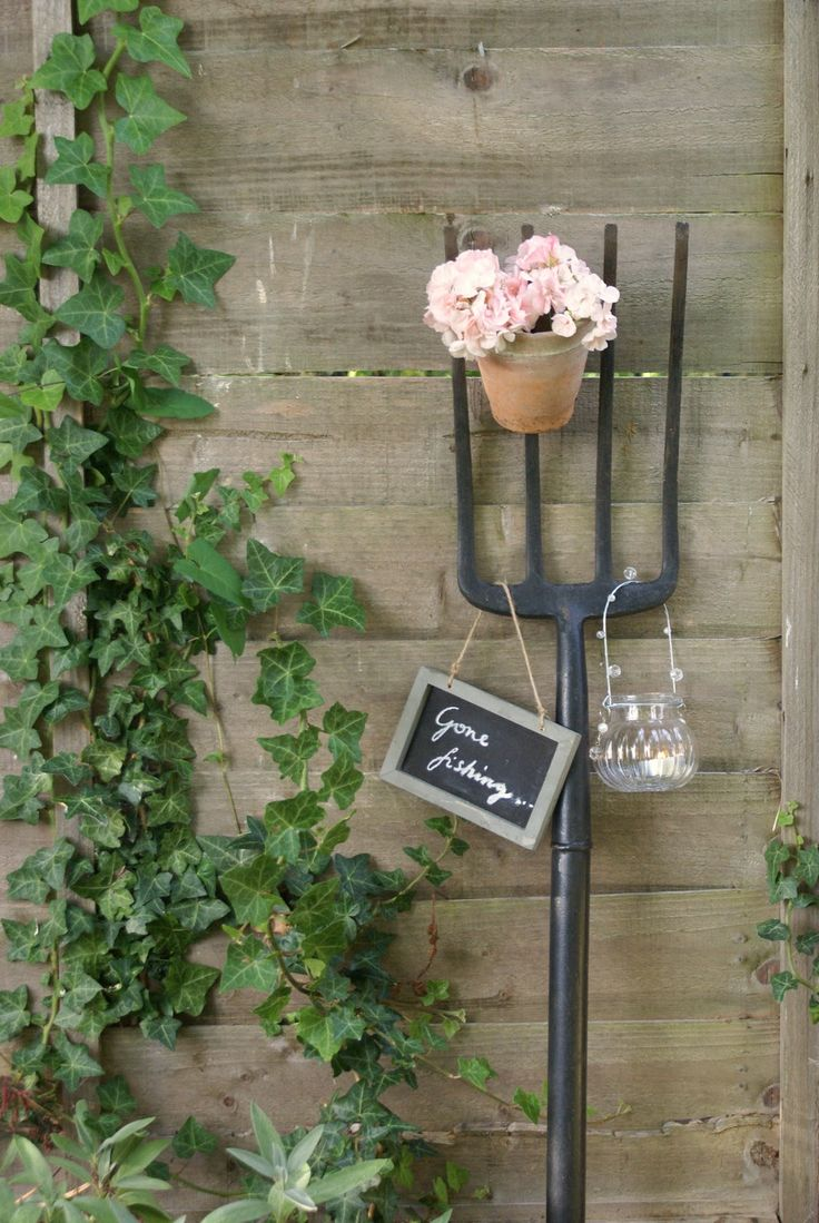 I found my vintage rake and hoe...now  I will have to keep a look out for one of these....I love the idea of hanging a sign from it as I love signs in my garden!!!
